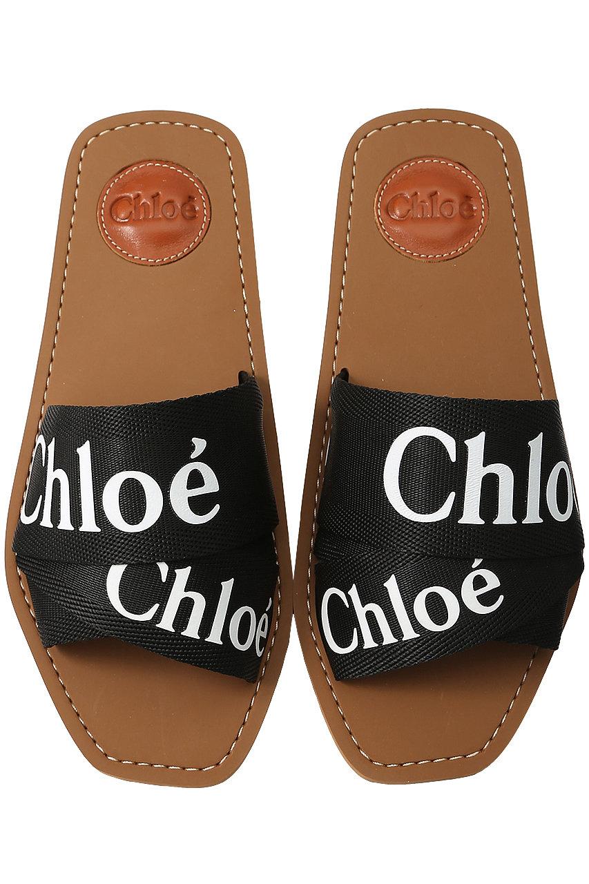 クロエ/ChloeのWOODY ロゴフラットサンダル(ブラック/CHC19U18808)